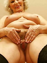 Dissolute mature GILF is spreading her lips