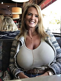Charming aged dame is revealing her hooters