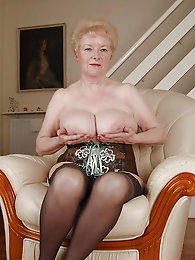 Dissolute older mama is spreading legs